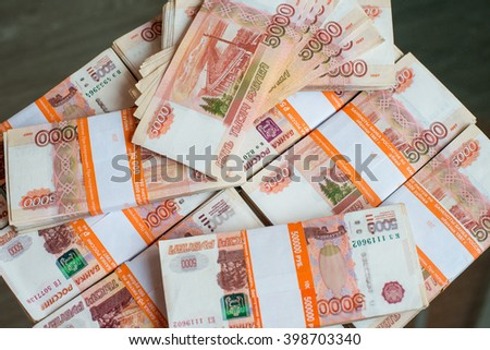 Money of the Russian Federation a lot of banknotes for five thousand rubles in a package - stock photo