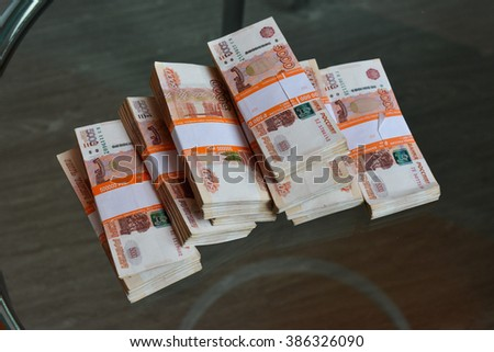 Money of the Russian Federation a lot of banknotes for 5000 rubles in a package - stock photo