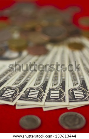 Money on a table - bills and coins - stock photo