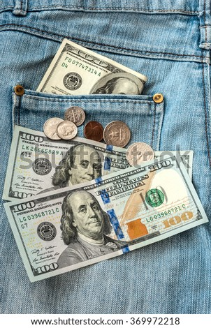 money on jeans background. - stock photo
