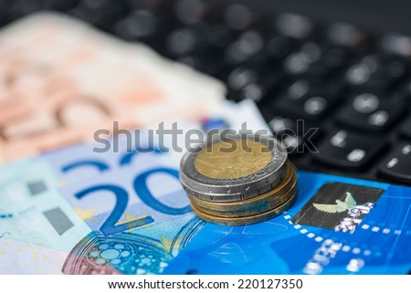 Money on keyboard of computer. Online banking. - stock photo