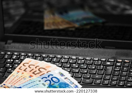 Money on keyboard. Online banking and transactions. - stock photo