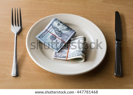 Money on plate with fork and knife, Business concept.