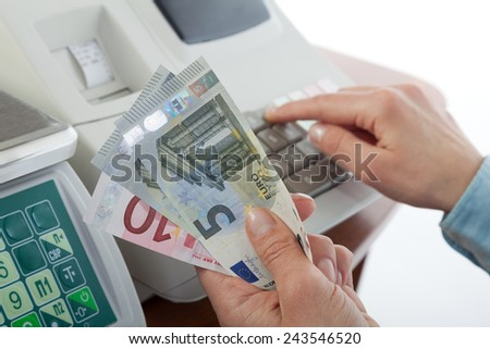 Money on the cash registers background - stock photo