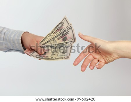 Money on the hands - stock photo