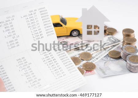 money, pile coin with account book and paper home, car, family on white background, business car and home finance insurance concept