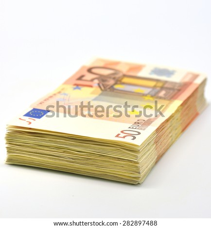 Money pile of 50 Euro banknotes isolated in white - stock photo