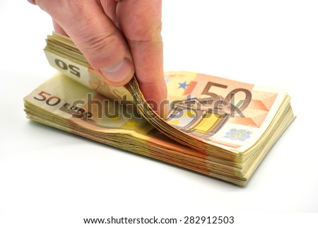 Money pile of 50 Euro banknotes isolated in white with hand count fortune