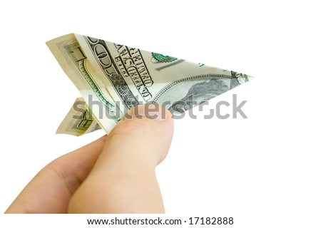 money plane in fingers isolated on white - stock photo