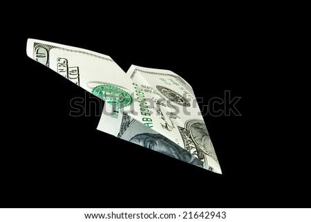 money plane isolated on black - stock photo