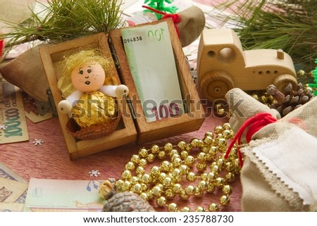 Money present in a small wooden box for a child on a festive background - stock photo