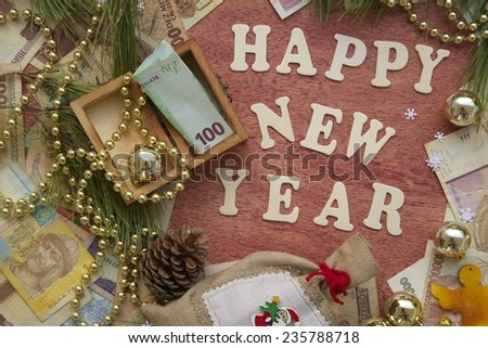 Money present in a small wooden box on a festive background - stock photo