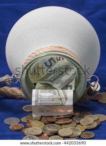 Money pulling out from a pot - stock photo