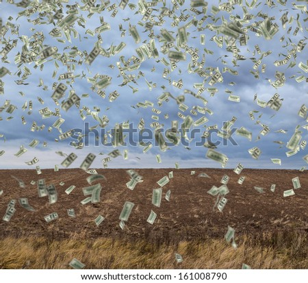 Money rain over an autumn field. - stock photo
