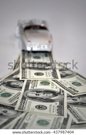 Money road concept with toy car