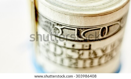 Money roll, roll of bills, roll of dollar bills. Shallow dof - stock photo