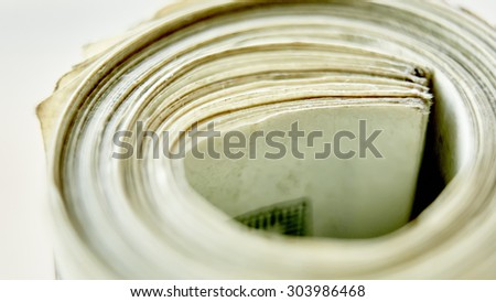 Money roll, roll of bills, roll of dollar bills. Shallow dof - stock photo