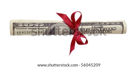 Money rolled with bow - stock photo