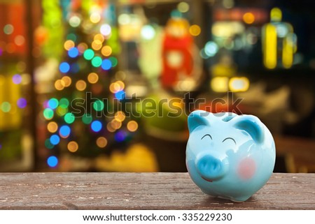money save on Christmas holiday determine by piggy bank with Christmas decoration background, abstract background to time to start saving or solution for save money for Christmas celebration holiday. - stock photo