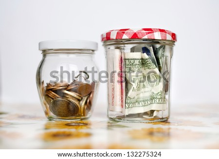 Money savings in the glass jars - stock photo