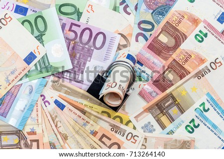money security concept - euro banknote and padlock