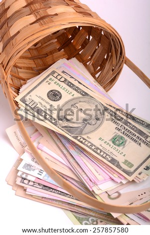 money set in a basket, Money from different countries: dollars, euros, hryvnia, rubles - stock photo