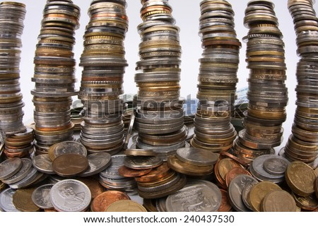 Money - Stacks of old coins from around the world. - stock photo