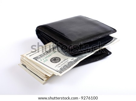 Money sticking out from wallet. White background. Shallow DOF. - stock photo