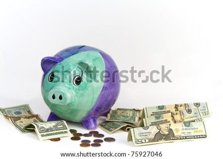 Money Surrounding Piggy Bank
