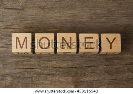 money text on wooden cubes - stock photo
