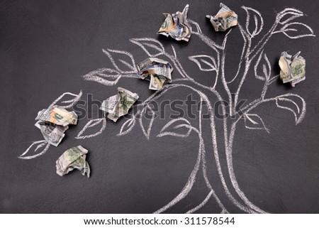 Money tree drawing on blackboard close up - stock photo