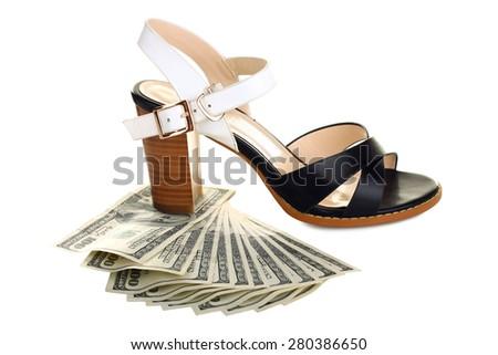Money under the heel sandals isolated - stock photo