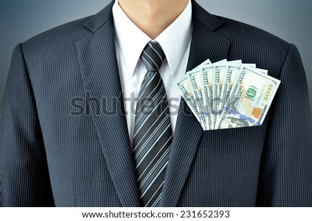 Money - United States dollar (or USD) banknotes in businessman suit pocket