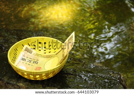 https://thumb1.shutterstock.com/display_pic_with_logo/167494286/644103079/stock-photo-money-washing-sarasvati-in-enoshima-japan-644103079.jpg