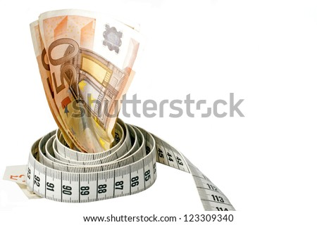 Money with a tape measure wrapped around it over a white background - stock photo