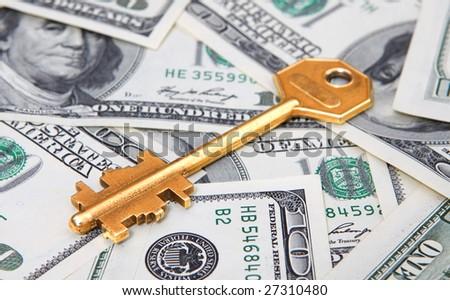 money with gold key - stock photo