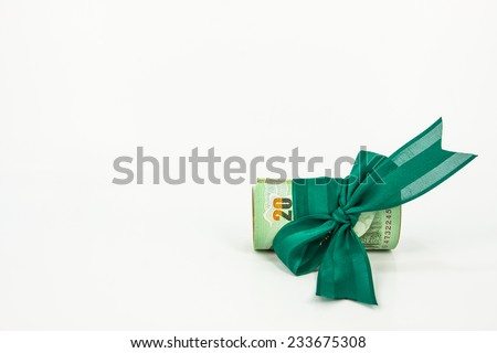 money with green ribbon on white background,money concept