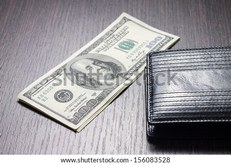 money with leather wallet on table - stock photo