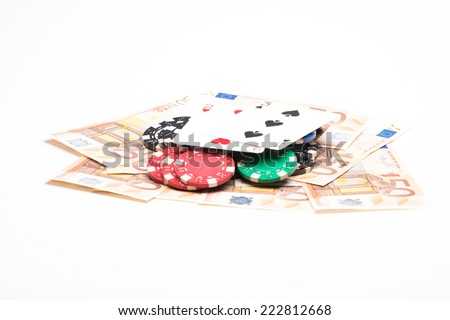 Money with poker chips and cards isolated on white background - stock photo