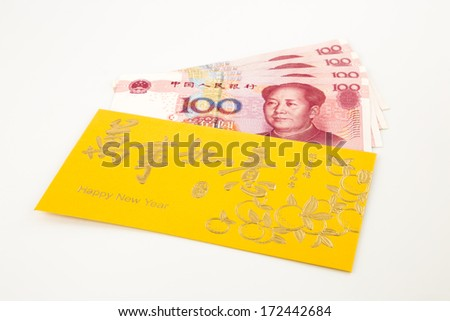 money yuan cash banknote and gold envelope, celebrate chinese new year and asian culture - stock photo