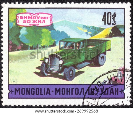 MONGOLIA - CIRCA 1971: A postage stamp printed in the Mongolia shows image of the motor industry history, circa 1971   - stock photo