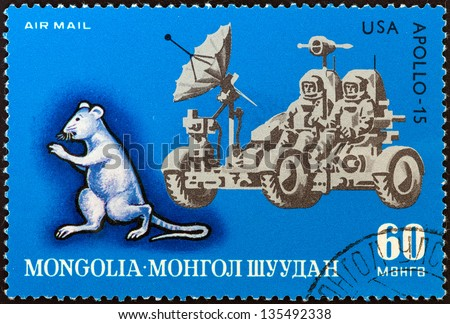 "MONGOLIA - CIRCA 1972: A stamp printed in Mongolia from the ""Animal Signs of the Mongolian Calendar and Progress in Space Exploration"" issue shows Rat and Apollo 15 lunar rover, circa 1972."
