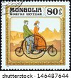 "MONGOLIA - CIRCA 1982: A stamp printed in Mongolia from the ""History of the Bicycle"" issue shows Coventry Rotary Tandem, 1870s, circa 1982.  - stock photo"