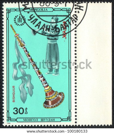 MONGOLIA - CIRCA 1986: A stamp printed in MONGOLIA shows Bishguur, from series Folk musical instruments, circa 1986