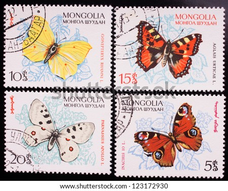 MONGOLIA - CIRCA 1963: A stamp printed in Mongolia shows four kinds of colorful butterflies , circa 1963. - stock photo