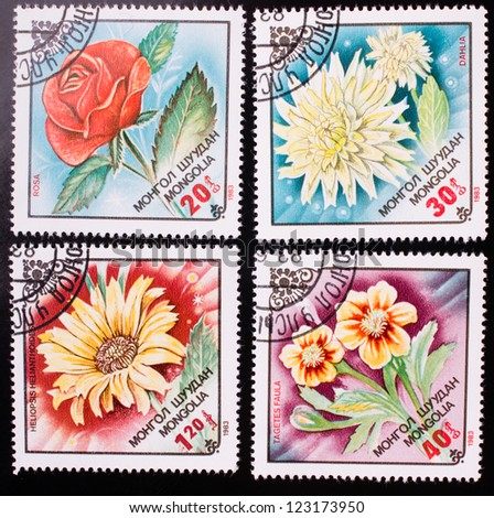 MONGOLIA - CIRCA 1983: A stamp printed in Mongolia shows four kinds of colorful flowers , circa 1983. - stock photo