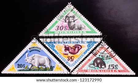 MONGOLIA - CIRCA 1977: A stamp printed in Mongolia shows four kinds of wild animals , circa 1977. - stock photo