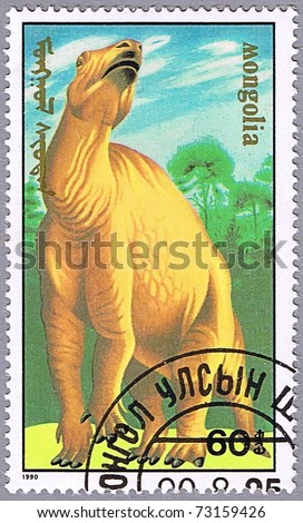 MONGOLIA - CIRCA 1990: A stamp printed in Mongolia shows Iguanodon, series devoted to prehistoric animals, circa 1990 - stock photo