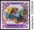 MONGOLIA - CIRCA 1980: A stamp printed in Mongolia shows PACKARD 1909 a old car, circa 1980. - stock photo