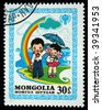 MONGOLIA - CIRCA 1980: A stamp printed in Mongolia shows pioneer holding umbrella under a girl, circa 1980. - stock photo
